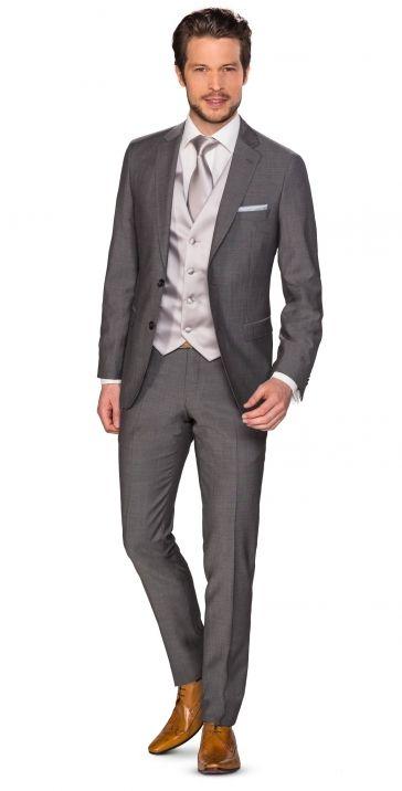 Donker grijs pak met lichte kleuren