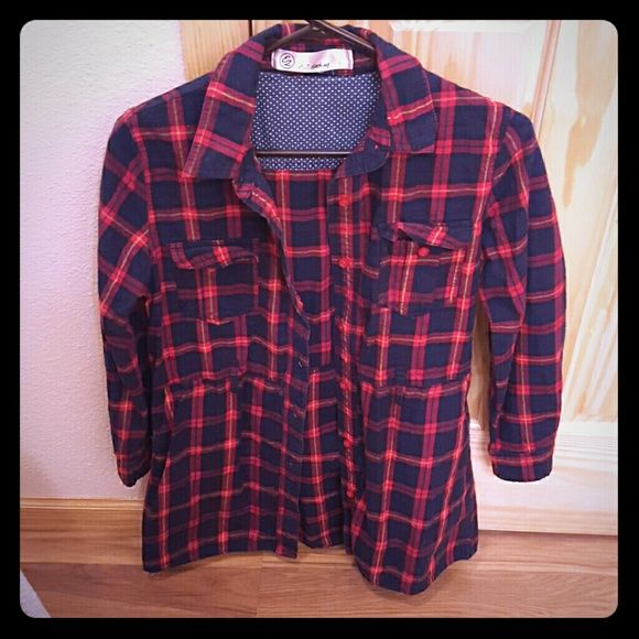 E2 button flannel tunic. Small e2 button up flannel tunic. Has loop for belt and also side pockets. Good condition. Navy, red and small yellow stripes in color. e2 Tops Tunics