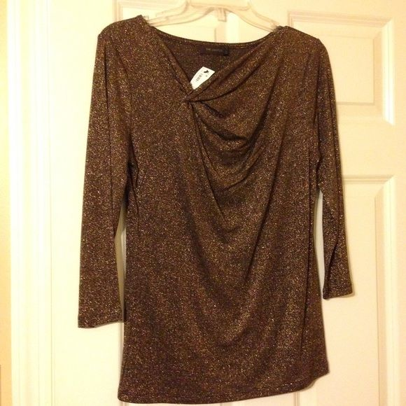 Gold long sleeve top from The Limited NWT Gold, long sleeve top from The Limited. Appealing asymmetric neckline. Perfect for a night out or dressing up an every day outfit! The Limited Tops