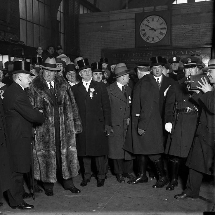 "Chicago Mayor William Hale ""Big Bill"" Thompson in fur welcomes William Thomas Cosgrave (far left) the first president of the Irish Free State (shaking hands) to Chicago at the LaSalle Street train station January 1928. The Tribune reported that Thompson shook Cosgrave's hand enthusiastically and ""fairly enveloped him in the fur coat he wore."" #chirish #1920s #chicagowelcome #chicagomayors by vintagetribune"