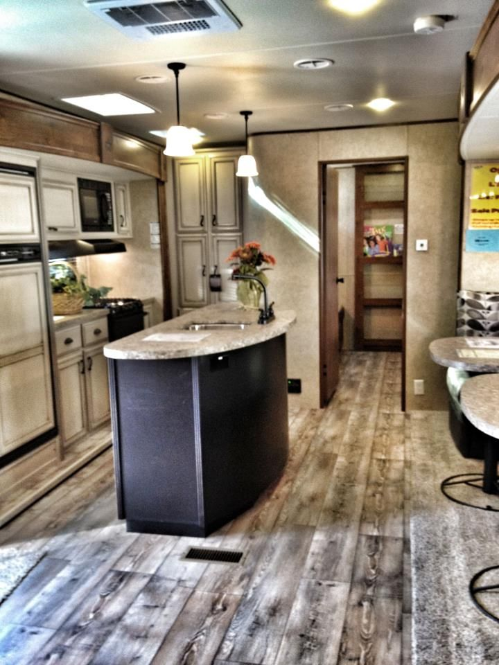 "Open Range Light LT 398BHS travel trailer. 4 wood tones, including very rustic floor. 2-tone kitchen. This decor package is called ""Steel""."