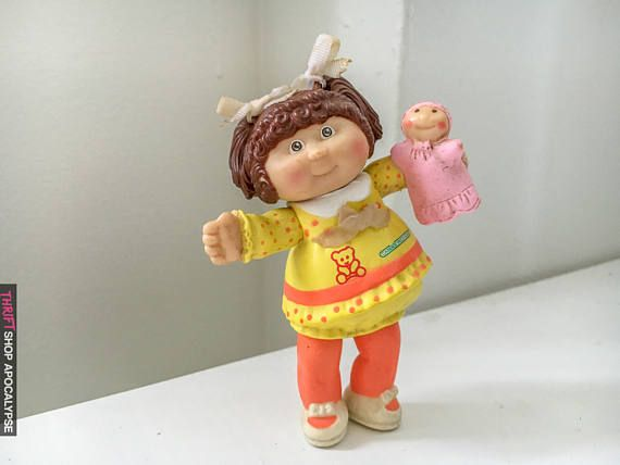 Vintage 1984 #Posable Cabbage Patch #Doll w/ a strange #baby in hand that resembles Strega Nona.   Mcdonalds Happy Meal Toy. Some wear and discoloration from age.   About 2 in... #90s #kid #toys #doll #posable #bows