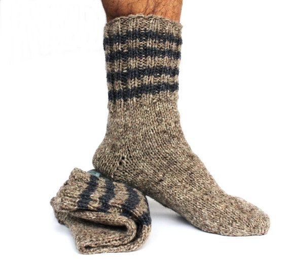 Colorful hand knitted mens wool socks.  Traditional handmade woolen socks and slippers are preferred in very cold weather. Maximum handwashing