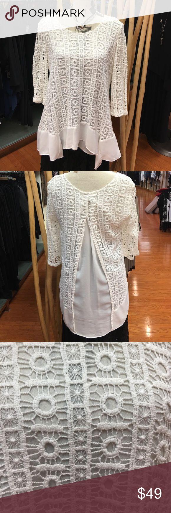 Off white crocheted top. Off white crocheted top. Three quarter sleeve. Lined. Split back detail. Handkerchief Style border. Monoreno Tops Blouses