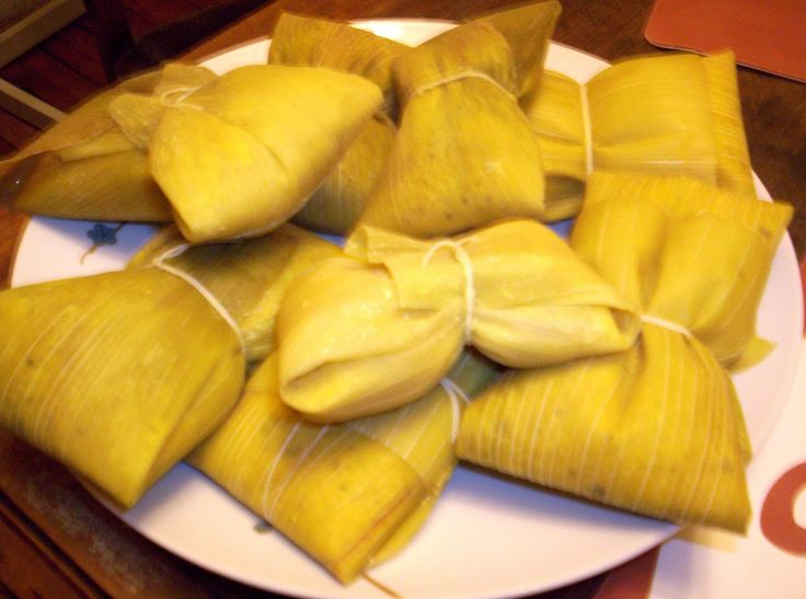 Humitas in Chile are prepared with fresh corn, onion, basil, and butter or lard. They are wrapped in corn husks and baked or boiled. They may contain ají verde (green chili pepper). The humitas are kept together during cooking with thread or twine. They can be made savory, sweet, or sweet and sour, served with added sugar, chile pepper, salt, tomato, olive and paprika etc.