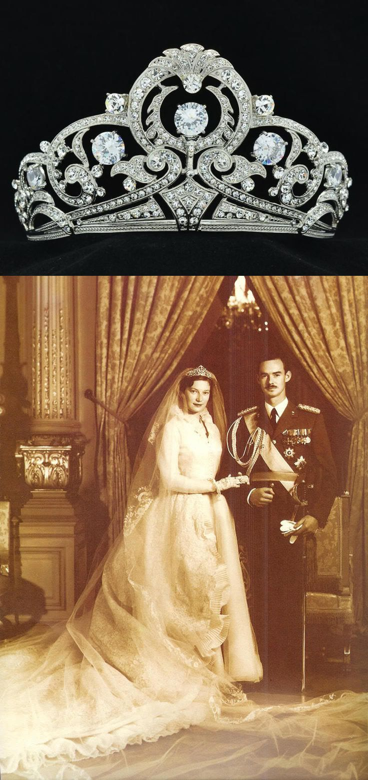 [Belgian Scroll Tiara. This piece was a wedding gift from the Belgian National Bank to Princess Josephine-Charlotte of Luxembourg. She wore during her wedding to Grand Duke Jean in 1953. It is now worn by daughter-in-law, Grand Duchess Marie Teresa. This diamond tiara was made by Henry Coosemans and is made of no less than 854 diamonds and set in platinum. The tiara includes a detachable diamond of 8.10 carats to be worn as a ring. The central panel can also be detached and worn as a…