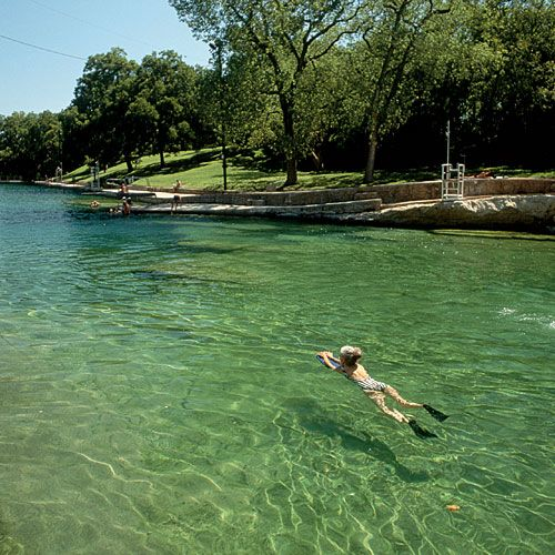 Barton Springs Pool is spring-fed and over 900 feet long with a natural rock bottom. Austin, TX
