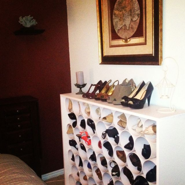 PVC + laminated particle board + Goop Glue = fabulous, space saving shoe rack! (with tutorial) would consider wrapping pipes in old maps for detail