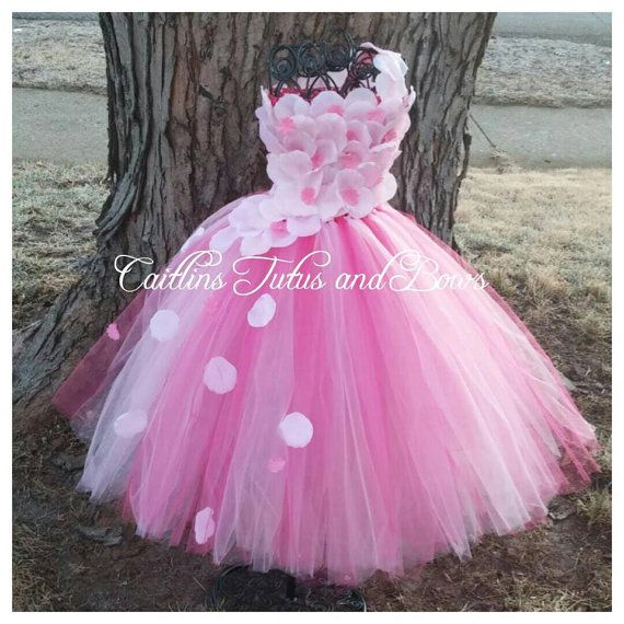 This stunning tutu dress is perfect for a flower girl in a wedding, or a special dress for a pageant, or even a special little birthday
