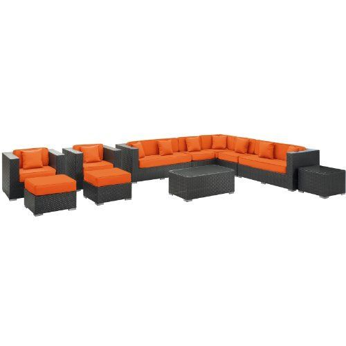 East End Imports Cohesion Outdoor Rattan 11 Piece Set in Espresso with Orange Cushions by East End Imports. $6383.64. • All Weather Synthetic Rattan Weave • Powder Coated Aluminum Frame • Water & UV Resistant • Machine Washable Cushion Covers • Easy To Clean Tempered Glass Top • Ships Pre-Assembled • Item Ships in 2 - 3 Weeks. Preside steadfastly at each assembly as concurrent movements take you forward. The Cohesion Outdoor Sectional Set brings you to a place of...