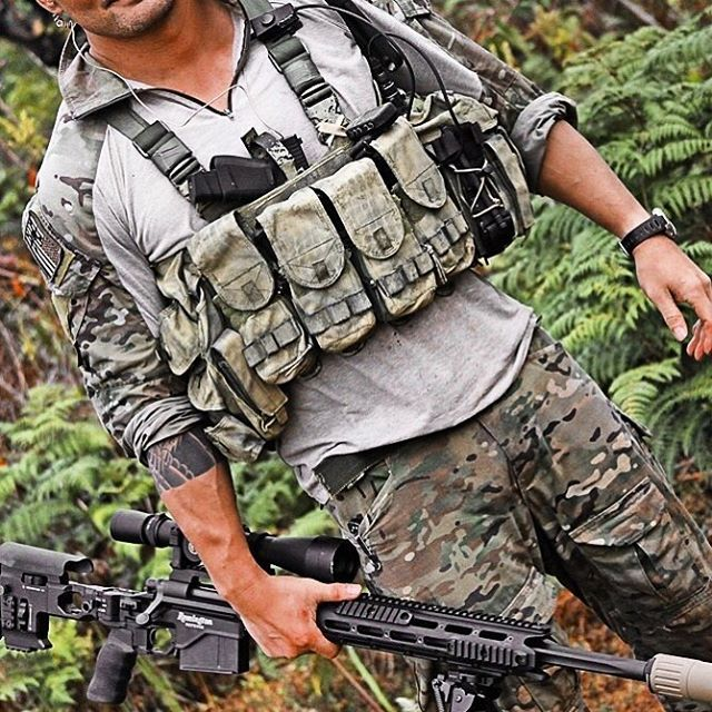 Military style camouflage and chest rig.
