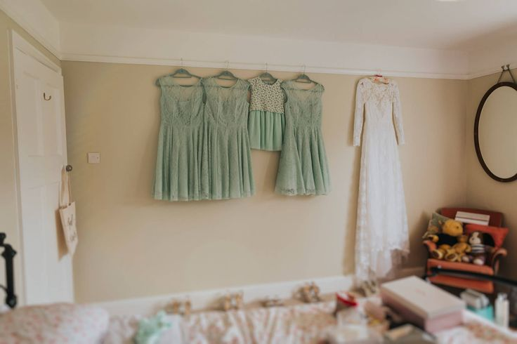 Having somewhere spacious to hang the bridesmaid and wedding dresses is important to let the creases fall out - it also makes for a nice photo! Photo by Benjamin Stuart Photography #weddingphotography #weddingdress #bridesmaids #mintgreen #dresses #weddingday #bridesmaiddresses