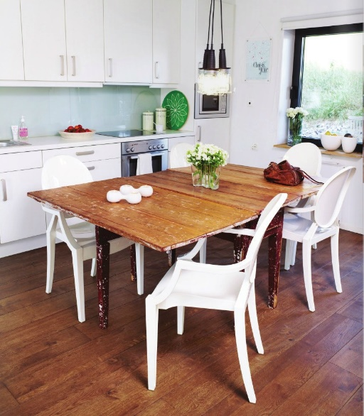 i like the look and feel of this distressed wooden table and white chairs, it also is in the beachy theme.
