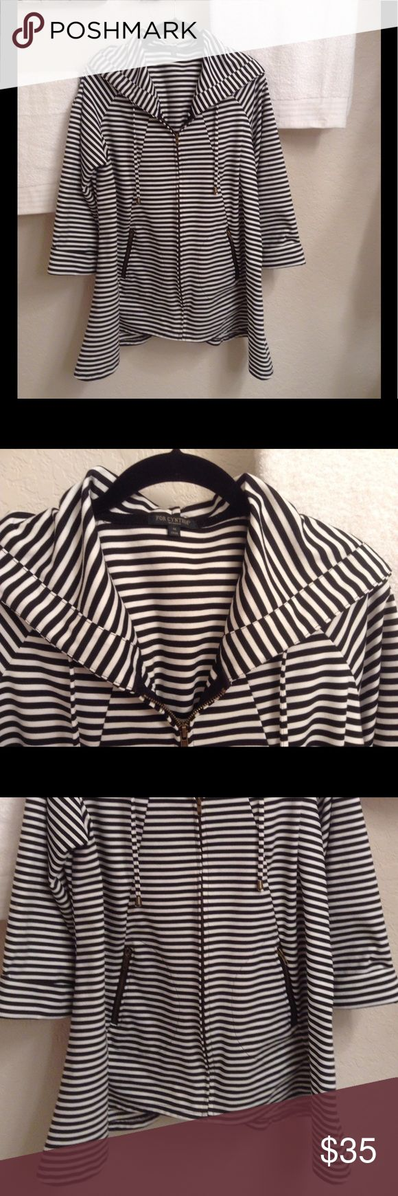 FOR Cynthia Woman Jacket Beautiful!!  This black & white striped jacket has a full zip up front, a drawstring closure hood, longer bottom sides, 3/4 rolled up sleeves, a 2 button cinch in the middle back, and 2 bottom front zip up pockets.  It's 96% Polyester/4% Spandex.  The chest measures 48 inches & the length is 30 inches. Cynthia Rowley Jackets & Coats