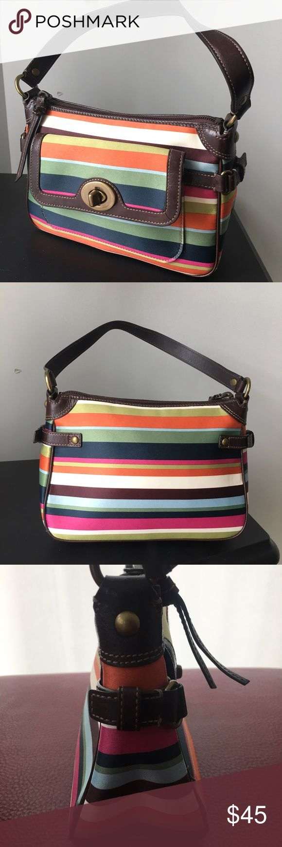 Coach Legacy Poppy Stripe Bag Beautiful Coach Legacy Poppy Stripe Bag 41852. Sateen Handbag has turnlock on the front pocket with shoulder strap on O rings. Like new condition. Material repels rain. Measures 8x5.5x3 Coach Bags