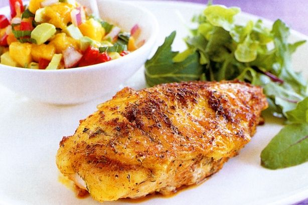 Team Cajun chicken breasts with vibrant mango salsa to create a complete mid-week meal.