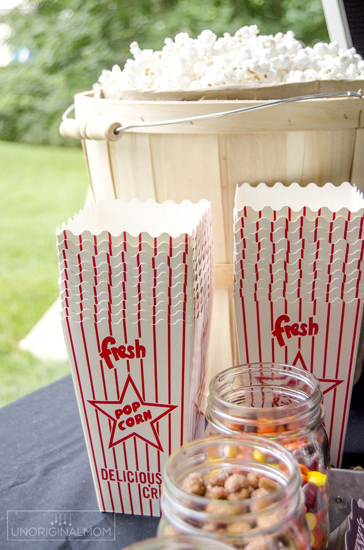 Super fun popcorn bar for an outdoor movie night - with printables and Silhouette cut files, too! | Popcorn bar printables | backyard movie night | movie party | chalkboard popcorn bar printables | movie night ideas | popcorn bar labels | movie night printables