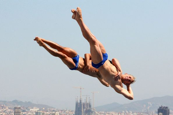 Chris Mears and Nicholas Robinson-Baker of Great Britain compete in the Men's 3m Synchro Springboard Diving preliminary round on day four of the 15th FINA World Championships at Piscina Municipal de Montjuic on July 23, 2013 in Barcelona, Spain.