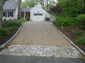 Driveway entrance to help retain the gravel