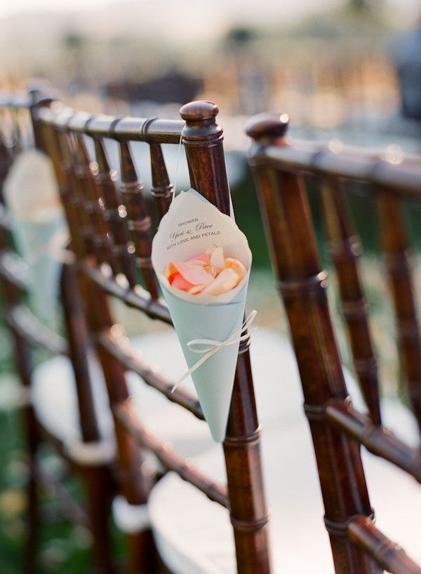 i think I pinned something like this already but it is a cute way to decorate plain chairs and the petals make for a beautiful send off