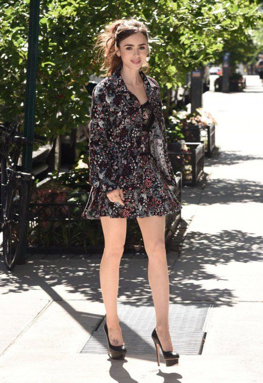 82400a660b5 Lily Collins elegant street style in a floral mini dress and high heels