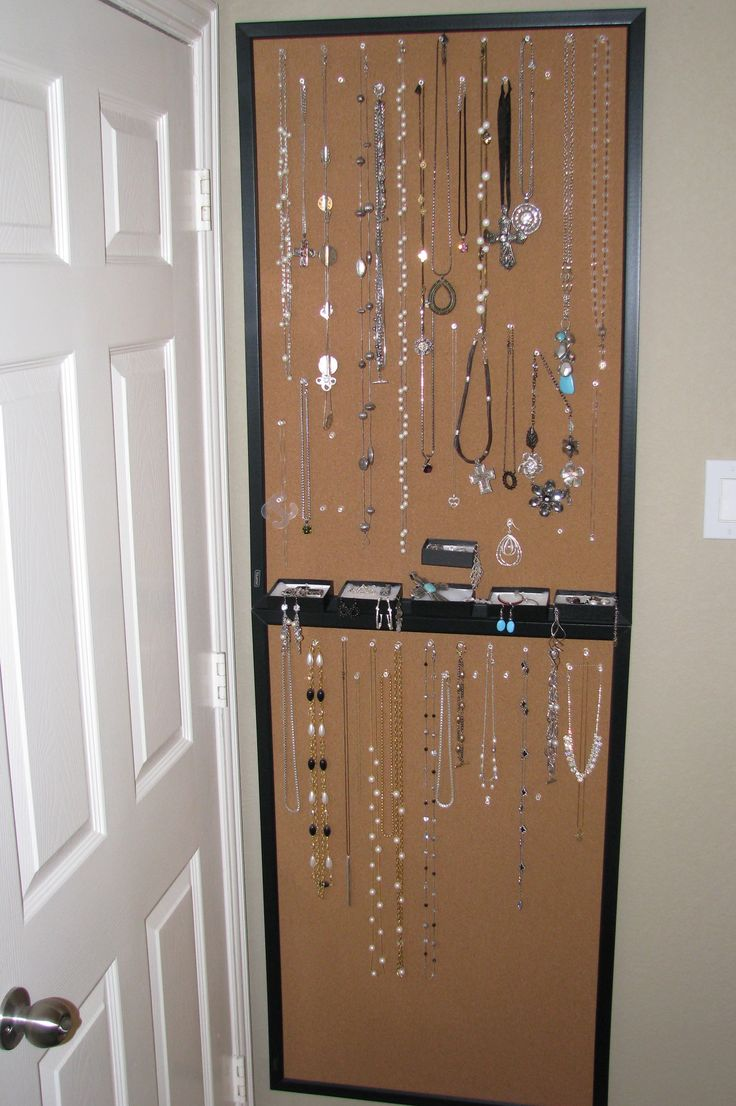 Pinner says: I took two large cork bulletin boards and mounted them vertically on the wall (this location is behind our bathroom door). Then I took push pins and placed them along the top and other strategic locations for necklaces and bracelets.   And using tiny screws fixed small Park Lane jewelry boxes along the middle to hold rings, earrings and other misc. items.