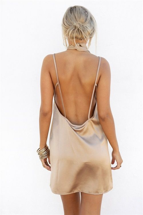 REGISTER TO RESTOCK IF YOU WANT TO SEE THIS BACK IN STOCK<br/><br/>Simplistic and sexy, the Silky Slip Dress is the perfect outfit for your next occasion! Made from a silky fabric in a speckled bronze hue with a light shine, it features a deep V neckline with thin straps, low back with strap detailing and comes with included waist tie. Exclusively designed by Sabo Skirt.
