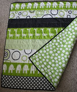 simple strip quilt, just piece together several strips of coordinating fabrics, add batting and a backing, stitch-in-the-ditch, and bind. easy!