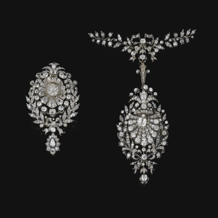 PROPERTY OF A NOBLEMAN Diamond pendant and diamond pendant/brooch, circa 1880 Each pendant designed as scallop shell within a foliate and ribbon frame, set with cushion-, pear-shaped, circular-, single-cut and rose diamonds, one with brooch pin and pendant loop detachable, additional articulated foliate and ribbon surmount en suite, one small diamond deficient, both with fitted case stamped Médaille d'Or 1878, Durand-Leriche, Fabricant, 4, rue Montesquieu, Paris.