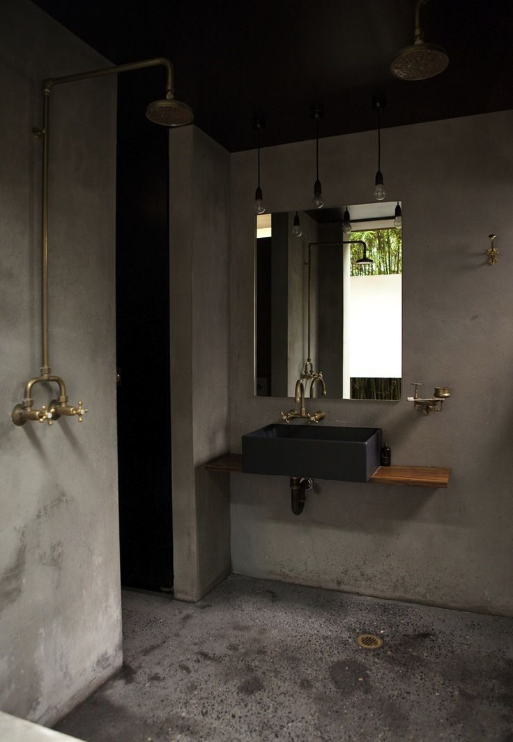 bathroom | concrete wall with brass details