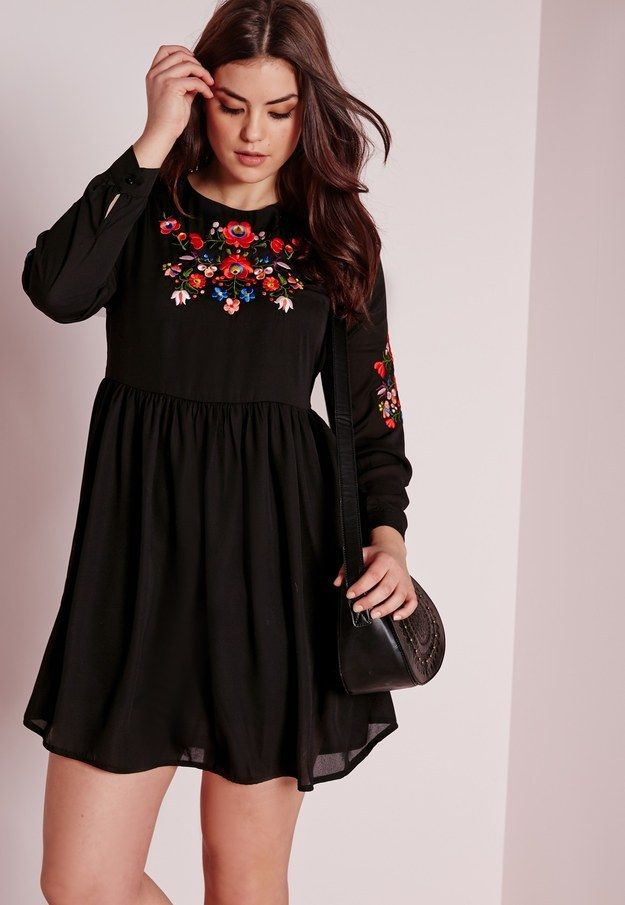 A dress with a burst of floral embroidery.
