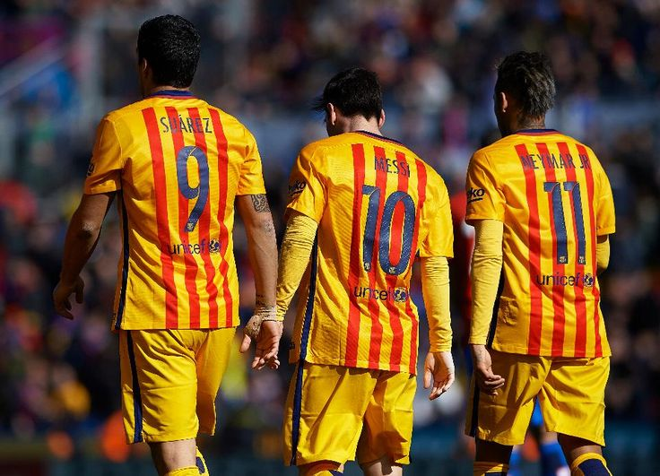 Luis Suarez, Lionel Messi and Neymar JR of Barcelona walk on the pitch during the La Liga match between Levante UD and FC Barcelona at Ciutat de Valencia on February 07, 2016 in Valencia, Spain.