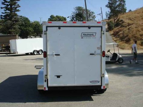"""2016 New Haulmark TSV6X12DT2 Toy Hauler in California CA.Recreational Vehicle, rv, 2014 HAULMARK TSV6X12DT2, HAULMARK TSV6X12DT2 TRANSPORT DLX WITH A DUAL SPRING ASSISTED RAMP DOOR W/16"""" PLYWOOD EXTENSION FLAP. THIS TRAILER ALSO COMES WITH A 18"""" V-NOSE, 2 3500LBS ELECTRIC BRAKE AXLES, EMERGENCY BREAKAWAY, 16"""" ON CENTER CROSSMEMBERS, 2000LBS TOP WIND JACK W/SAND PAD, EZ-LUBE HUBS, ST205/75R15 TIRES, .030 POWDERCOATED ALUMINUM SIDING,1-PIECE ALUMINUM ROOF,24"""" ATP STONE GUARD ON FRONT, 3/8…"""