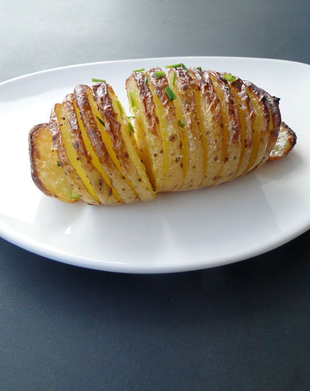Baked Hasselback Potatoes: Crisp on the outside, tender on the inside, seasoned with Parmesan, garlic, olive oil & smoked paprika with a sprinkle of chopped chives, wonderfully appealing! Named after the Stockholm restaurant Hasselbacken where it was first served.