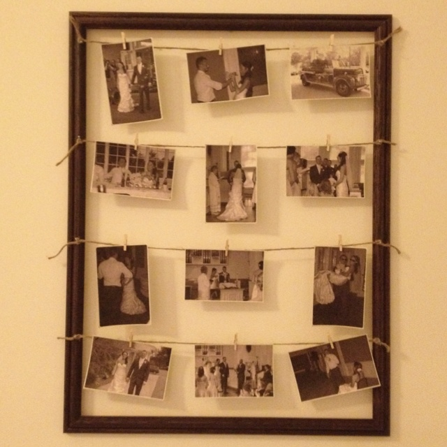 Displaying our wedding pictures in 18x24 frame. Cost me less than $20 to do! 15 frame from Pat Catans, tiny clothes pins for 1.50, twine for 2, and I printed the pictures on card stock I already had.....love it~