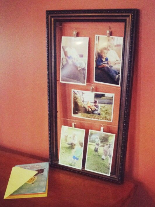 "Needed a gift for my dad's birthday. Found a frame, some wire, staples. Used the wire and clips from Ikea (""Deca""). Bam. Free DIY picture frame."