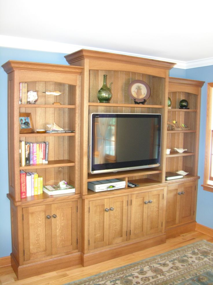 CustomMade by Norma Orsinger  Entertainment center constructed of solid rift sawn White Oak with solid quarter sawn White Oak panels. Finished with brown Oak stain and two part Polyurethane.