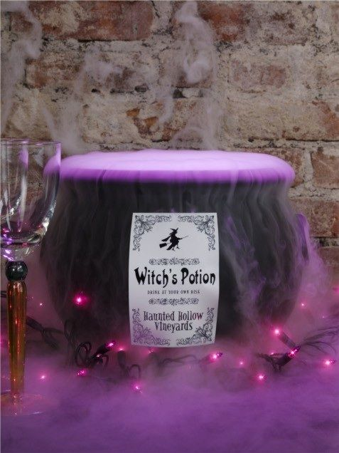 Halloween cauldron with purple fog potion & lights. Can't believe I've never done fog with all the Halloween parties I've thrown