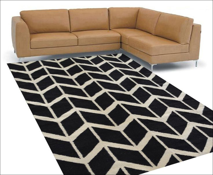 The Black Handwoven Woollen Durrie Rug is a beautiful modern floor rug. View here: https://www.rugsofbeauty.com.au/collections/winterton/products/handwoven-woollen-durrie-rug-sweden-1054-black