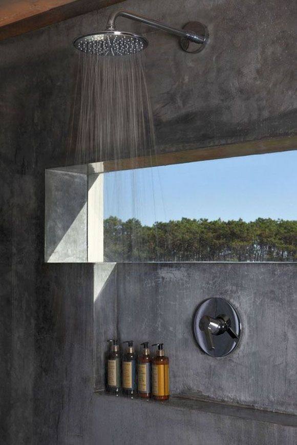 Concrete shower with a well-placed window.