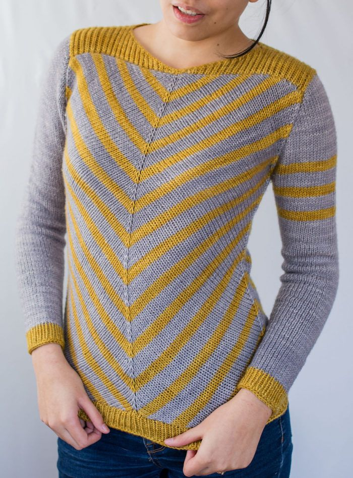 Knitting Pattern for Aumangea Pullover - Long-sleeved fitted sweater features a 2 color graphic design of chevron stripes. Aumangea is the Maori word for strong, brave, plucky or tenacious. Worsted weight yarn. Sizes S (M, L, XL) with 4″ of negative ease Designed by Francoise Danoy