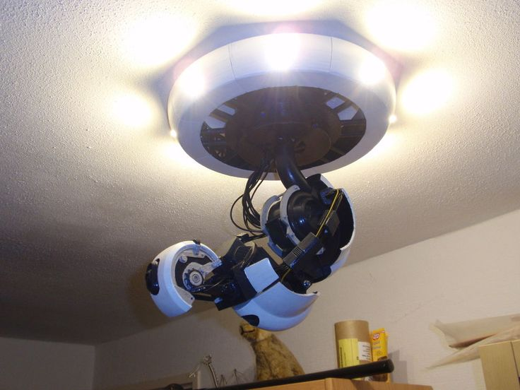 A fully 3D printable GlaDOS Robotic ceiling arm lamp from Portal and Portal 2