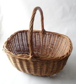 Baskets for school cookery lessons, with an elasticated, floral plastic cover.