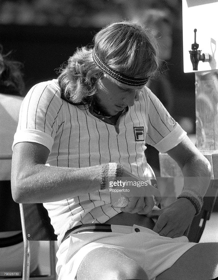 Sport, All England Lawn Tennis Championships, Wimbledon, London, England, 29th June 1976, Sweden's Bjorn Borg sprays pain-killer onto his injured stomach muscle