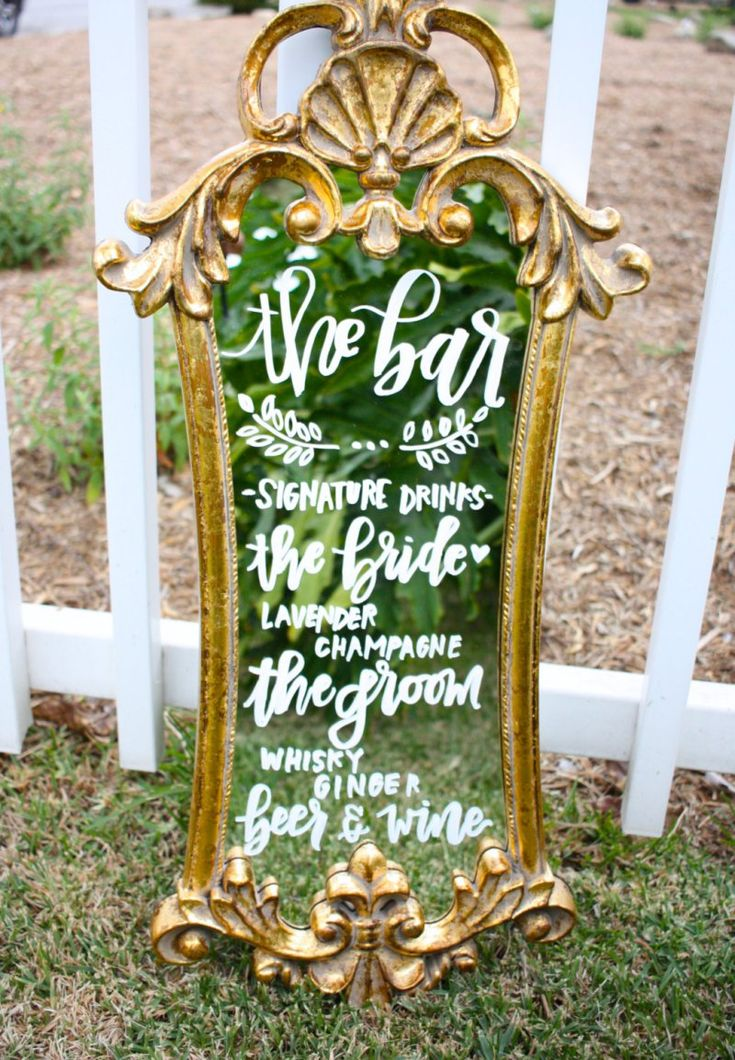 This decorative bar mirror is ideal for displaying a signature cocktail at your wedding. | http://emmalinebride.com/decor/wedding-mirror-signs/
