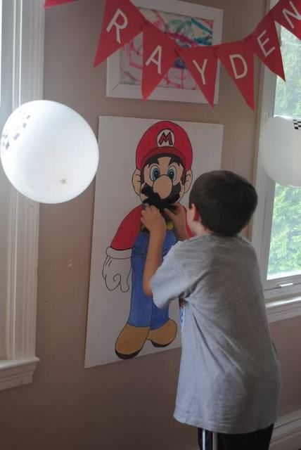 Pin the Mustache on Mario game at a Super Mario Bros Party @Crystal Chou Chou Akers