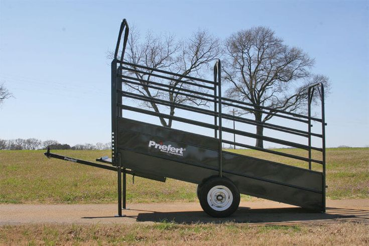 This 12' loading chute features a cleated Rumber floor, adjustable support legs for different loading heights, and a sliding hideaway tow bar with hitch attachment.