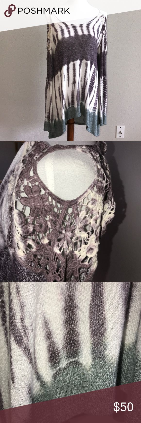 """Cold Shoulder Tie Dye Tunic Purple, Ivory & Green Poly/Rayon Blend. Knot Tunic with Embroidery on shoulder and arm. Three quarter sleeve. Measures 21"""" Armpit to Armpit, 31"""" from back of Neckline to back Hem, 24"""" from base of Neckline to front hem. Fits generously. Brand is T ⭐️ Party. Size large. Made in the 🇺🇸. T Party Fashion Tops Tunics"""