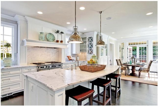 Love all the white in this kitchen, especially the the shelf over the
