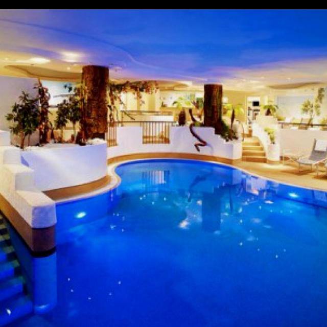Blue Pool Inside The House. WOW JUST AMAZING! I Dont Know If I Could Live  In A House Like That But Going On Vacation To One.hell Yes!